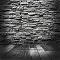 Room stone wall wooden floor grunge style Royalty Free Stock Images