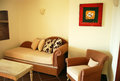 Room with table, arm-chair and sofa. Royalty Free Stock Photo