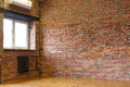 Room with a window, red brick walls and wooden flooring of boar Royalty Free Stock Photo