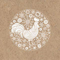 Rooster and snowflakes. Rooster- animal symbol of new year 2017. Vector illustration in the circle on kraft paper, isolated eleme