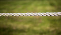 Rope against green a straight a background Royalty Free Stock Photo