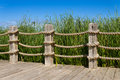 Rope bannister and wooden post railing Royalty Free Stock Photos