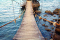 Rope bridge from the coast to a small island Stock Photography