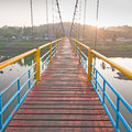 The rope bridge direct to another side in morning Stock Image
