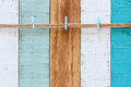 A rope with clips over background of vintage wooden planks in blue, aqua, turquoise and white Royalty Free Stock Photo