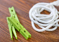 Rope and clothespin on a table Royalty Free Stock Image