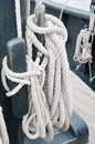 Rope coils on the nina detail of a halyard coiled neatly and secured a cleat authentic replica of one of columbus s sailing ship Stock Photography