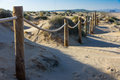 Rope fence on the sandy beach of La Mata. Sunset on the beach. Blurred unfocused background 03 Royalty Free Stock Photo