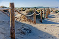 Rope fence on the sandy beach of La Mata. Sunset on the beach. Blurred unfocused background 02 Royalty Free Stock Photo