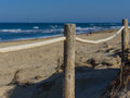 Rope fence on the sandy beach of La Mata. Sunset on the beach. Blurred unfocused background 01 Royalty Free Stock Photo