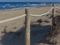 Rope fence on the sandy beach of La Mata. Sunset on the beach. Blurred unfocused blue sea background 04 Royalty Free Stock Photo