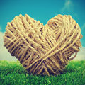 Rope heart on the grass Royalty Free Stock Photo