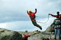 Rope jumping bungee jumping man off a cliff with a Royalty Free Stock Photo