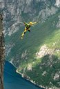 Rope jumping bungee jumping man off a cliff with a Stock Images