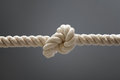 Rope knot tied on a white on gray Stock Images