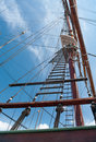 Rope ladder of the ship to main mast on blue sky background Royalty Free Stock Photo