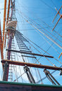 Rope ladder of the ship to main mast on blue sky background Stock Photos