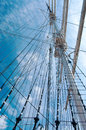 Rope ladder to the main mast of the ship on blue sky background Stock Photo