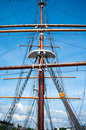 Rope ladder to the main mast of the ship on blue sky background Royalty Free Stock Images