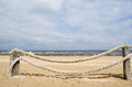 Rope log fence beach sand Royalty Free Stock Photo