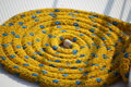 Rope mooring  yellow  on the deck Royalty Free Stock Photo