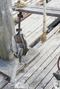 The rope on the rafter of an old wooden ship.