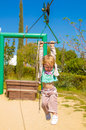Rope sliding little cute girl on the metal Royalty Free Stock Photo