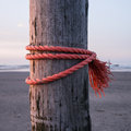 Rope on stake strong red wooden Stock Photo