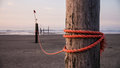 Rope on stake strong red wooden Royalty Free Stock Image