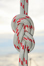 Rope tied in a knot sailing at sea background Stock Photography