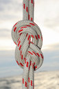 Rope tied in a knot sailing at sea background Royalty Free Stock Photo
