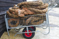 Rope on a trolley in fishing village Stock Photo