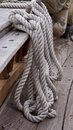 Ropes around a cleat old yacht Stock Photo