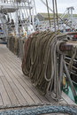Ropes and belaying pins on the deck of the polish tall ship dar mlodziezy during falmouth tall ships regatta falmouth cornwall Royalty Free Stock Images