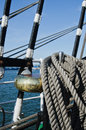 Ropes braided in bays on an ancient sailing vessel the Stock Photo