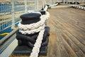 Ropes mooring and mooring bollard of a cargo ship Royalty Free Stock Images