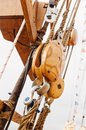 Ropes and wooden tackle blocks  of an sailing vessel Stock Photos