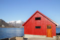 Rorbu and church of stamsund red cabins the small village in lofoten Royalty Free Stock Photos