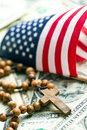 Rosary beads with american flag on us dollars background Royalty Free Stock Photography