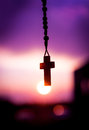 Rosary beads with beautiful sunset background Royalty Free Stock Photo