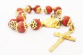 Rosary coral red and golden Stock Image