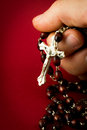 Rosary hand Stock Photos