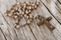 Rosary on old wooden background Stock Photos