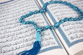 Rosary over holy Quran Stock Photo