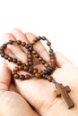 Rosary on palm wood with cross of human Royalty Free Stock Photography