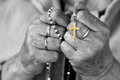 Rosary praying with a in black and white Stock Photos