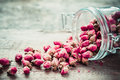 Rose buds in glass jar selective focus Royalty Free Stock Photography
