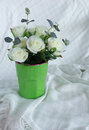 Rose bunch flower in green cup for decoration on silk tablecloth Royalty Free Stock Photos
