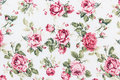 Rose fabric background fragment of colorful retro tapestry text textile pattern with floral ornament useful as Royalty Free Stock Photos