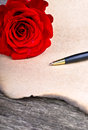 Rose flower and love letter on wood background valentines day Royalty Free Stock Photo
